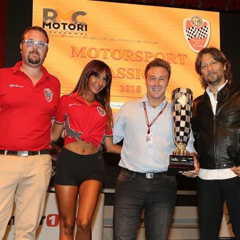 """Monza Fuori GP, """"Motorsport Passion"""", 1 September 2018: Dario Rolfi gives the """"Trofeo Freedom Of Moving"""" to Davide Valsecchi and to the Scuderia del Portello."""
