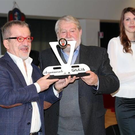 "Awards Ceremony ""Alfa Romeo Champions"", Arese, February 25th 2017: Marco Cajani, President of the Scuderia del Portello, gives the ""Eternamente Giulia"" trophy to Roberto Maroni, President of Lombardia Region"